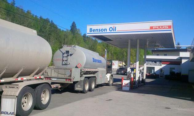 Castlegar's Downtown Shell - Benson Oil, showing fuel truck at station.
