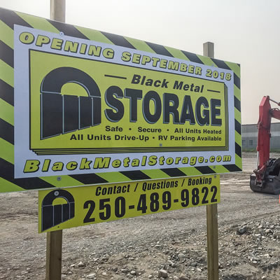 A sign advertising the future opening of Black Metal Storage.