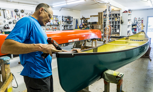 Bob Hellman works on a Hellman canoe