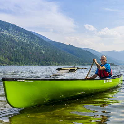 Bob Hellman, paddling on Kootenay Lake in one of his own canoes