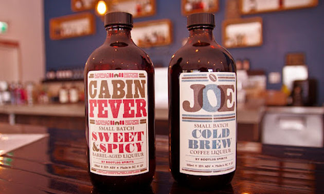 Bottles of Cabin Fever sipping whiskey and JOE coffee liqueur.