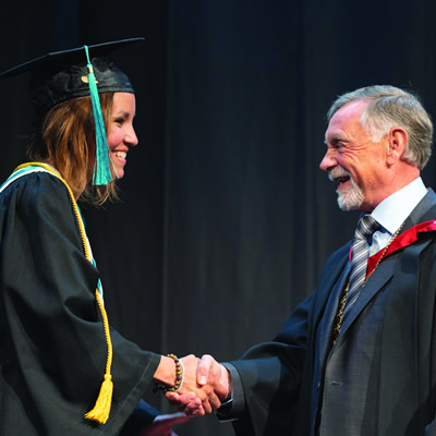 College of the Rockies President and CEO, David Walls, congratulates Lieutenant Governor's Medal recipient, Brenda Cortes Vargas, at the 43rd annual commencement ceremony on Friday, June 7.