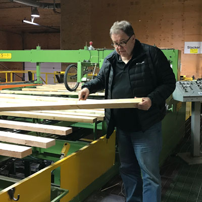 Brian Fehr points out the joints on a 2x4 at his Peak Industries plant off Theatre Road in Cranbrook and says this product is selling well.