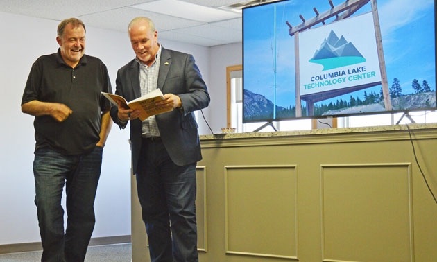 Premier John Horgan (R) showed up at the opening event of the Columbia Lake Technology Center in Canal Flats when Brian Fehr (L) announced his data centre in 2018, which is now one of the biggest manufacturers of Bitcoin in B.C.