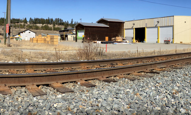 View of train tracks and industrial buildings.