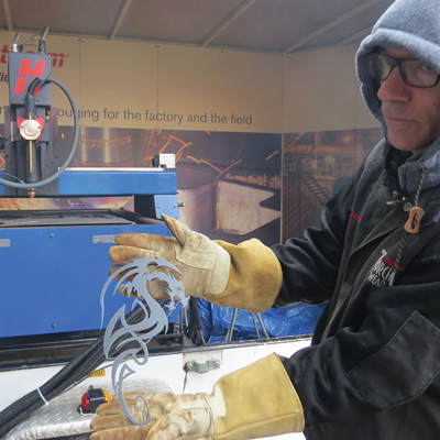 Vince Tucker from Hypertherm demonstrates the design capabilities of a plasma cutter.