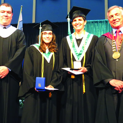 College of the Rockies Board of Governors member Jesse Nicholas (l) along with College President David Walls (r) presented academic medals to Shelley Bergeron (2nd from left) and Darcie Musil (2nd from right).