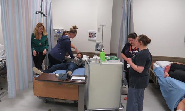 Nursing students practice their skills.