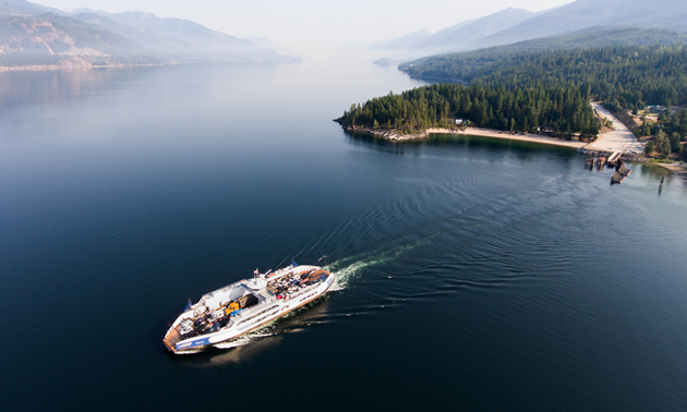 Kootenay Lake with a ferry crossing it