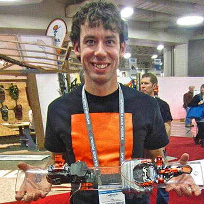 Cam Shute holding ski bindings.