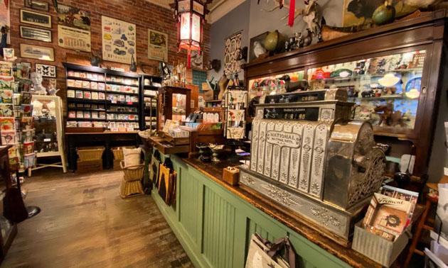 Interior of Cartolina store showing antique cash register and shelves.