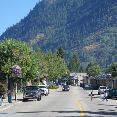 A rendering of street tree plantings along a boulevard with a multi-use pathway within Castlegar's Columbia Avenue Residential District