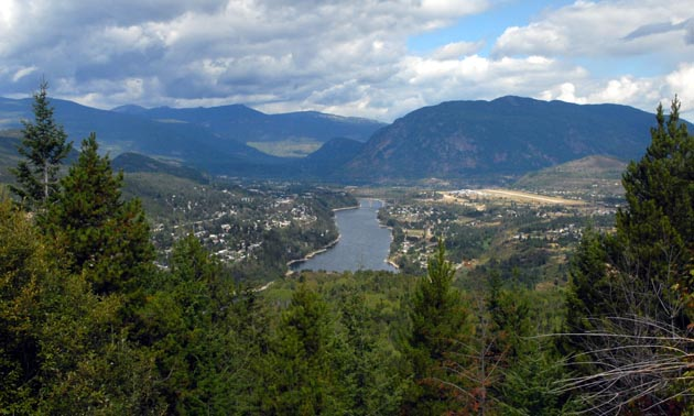 An aerial view of Castlegar shows the West Kootenay Regional Airport and the surrounding lands.