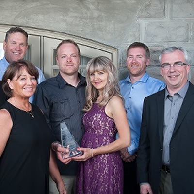 Chasse Holding's Jacques and Shelly Chasse plus Brady and Krystle Chasse receive their prestigious award from Canfor management.