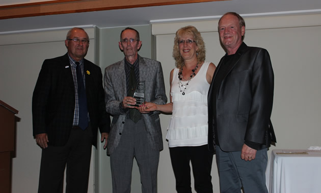 Castlegar mayor Lawrence Chernoff (left) congratulates the Oglow family on its Lifetime Achievement Award from the Castlegar & District Chamber of Commerce.