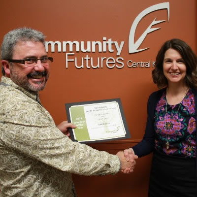Community Futures Central Kootenay Volunteer of the Year, Chris Bell and CFCK Executive Director, Andrea Wilkey.