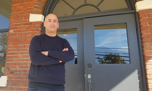 Chris van der Linden stands on the steps of the former Mountain View School, where renovations are being done to accommodate his restaurant, Old School Eatery, and other businesses.