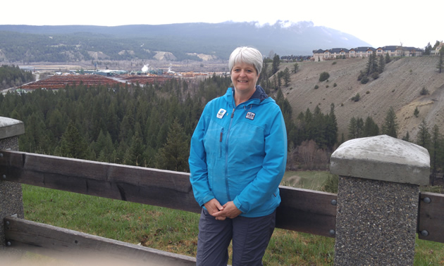Clara Reinhardt, mayor of Radium Hot Springs, with the beautiful Columbia Valley behind her