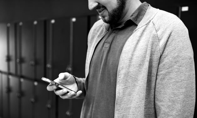 A man looking at his cellphone.
