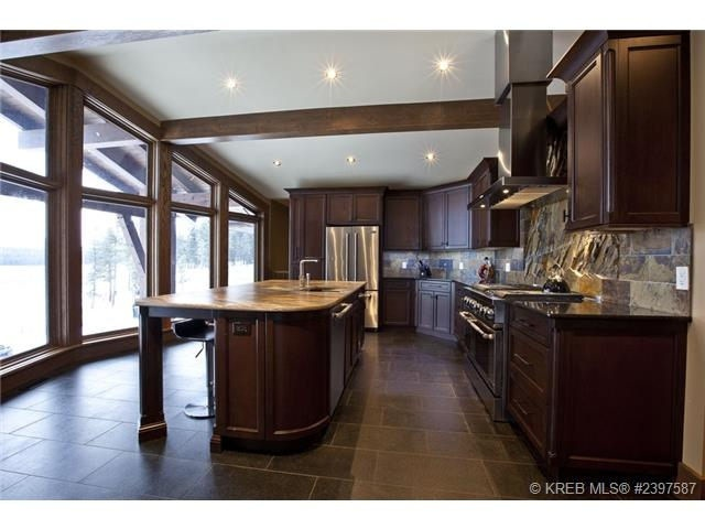 Looking out floor to ceiling windows from the Kitchen of the Cranbrook home for sale.