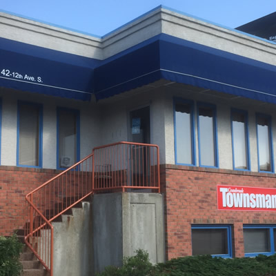 Location of Cranbrook Townsman - office building with steps leading up to front door.