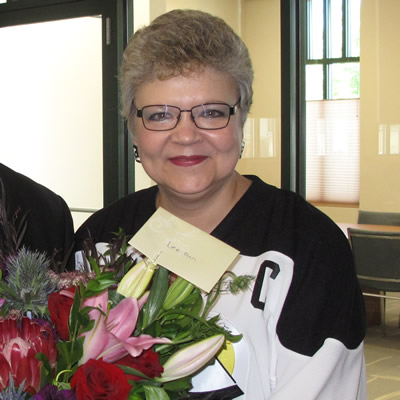 Dean McKerracher, mayor of Elkford, offers congratulations to RDEK CAO Lee-Ann Crane, on her retirement after 37 years with the organization.