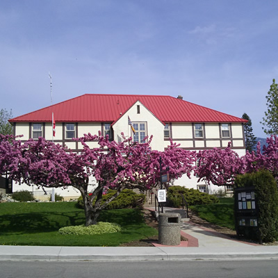 Flowering trees enhance the curb appeal of Creston Town Hall.