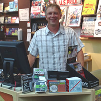Brad Crockett stands behind his counter at Crockett Book Company in Trail, B.C.