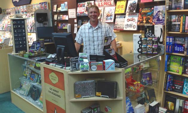 Brad Crockett stands behind his counter at Crockett Book Company in Trail, B.C.