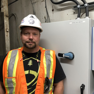 Curtis McLaren, owner of Kimberley Electric, in his hardhat and safety vest