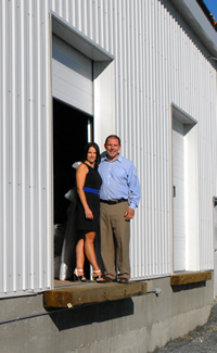 Joey and Christine Hoechsmann at the entrance of their new distribution centre located at the old Liquidation World location in Cranbrook, B.C.