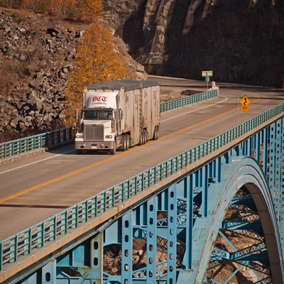 DCT Chambers truck on an elevated stretch of highway built on a mountainside