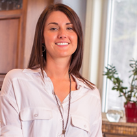 Young woman (Danielle Cardozo) in a bright kitchen