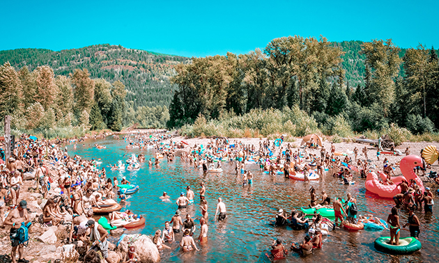 View of Salmo River full with beach goers.
