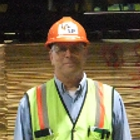 Man in safety gear at an industry plant.