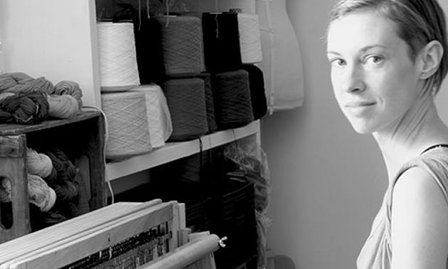 Dani Ortman, fibre artist, sitting at her loom.