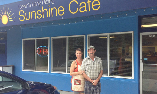 Tom and Kathy Frauley, owners and cooks at Dawn's Early Rising Cafe in Castlegar, stand outside their restaurant.