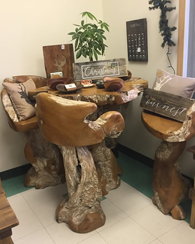 Set of tall bar stools made of wood.