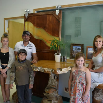 Jeremy and Sarah Smith and their three children in their store.