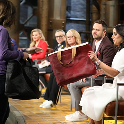 Shade Sails Canada staff is passing out bags from their second company at their Dragons' Den appearance in October.