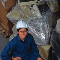 Christa Ford, a senior chemist at Teck Trail Operations, stands beside e-waste that will be recycled.