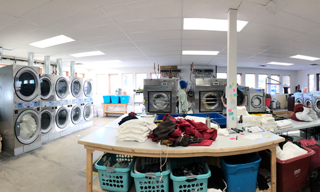 Inside view of the washers and equipment at East Kootenay Regional Laundry.