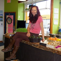 Nicole Du Vent sits on her countertop in her new health food store, Eat Pure Mountain Market, in Golden.