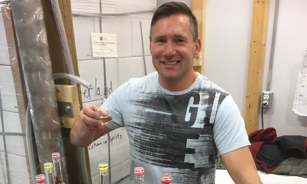 Cheers! Owner of Elder Bro's Farm and Distillery, Attila Lepsis, holds up a glass of produced-on-the-farm Schnapps.