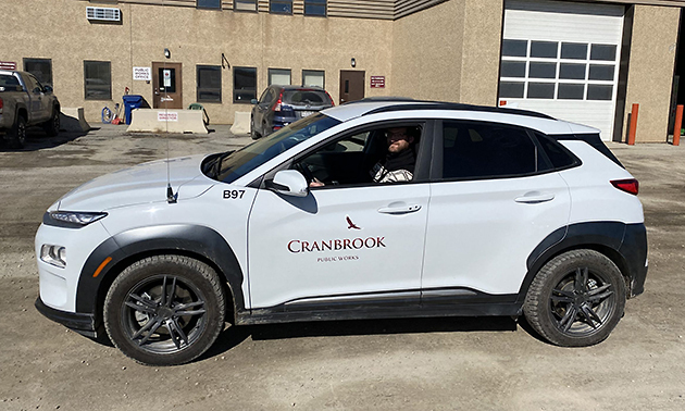Evan Berry, energy conservationist for the City of Cranbrook, takes a ride in the City's first electric vehicle.