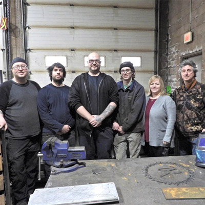 Team at Elk Valley Precision & Cab Inc. in Sparwood, taken in industrial shop.