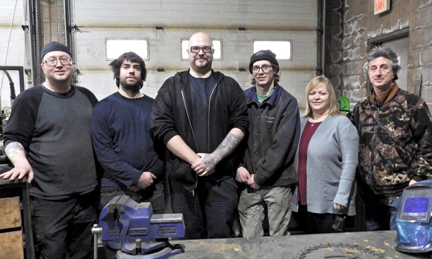 Team at Elk Valley Precision & Cab Inc. in Sparwood, taken in industrial shop.