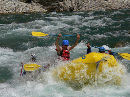 Person white water rafting