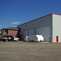 Industrial building with three garage-style doors