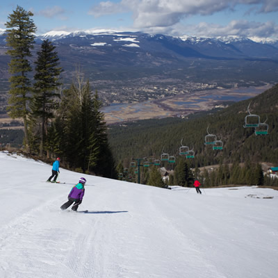 People skiing down ski hill